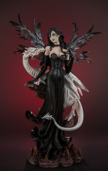 Dark angel with dragon statue: A picture of a dark angel with a white dragon