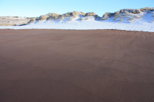 Winter beach 1: Snow on the sand!