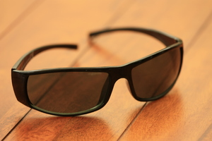 Sunglasses: Sunglasses on a wooden table