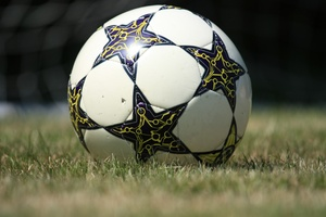 Football: A football on grass