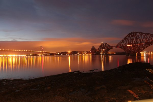 Forth Bridges at night: View of the Forth Bridges at night