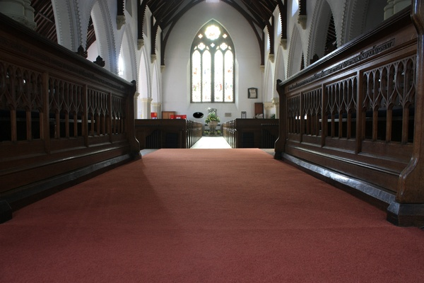 View from the chancel: View from a church chancel down the main aisle
