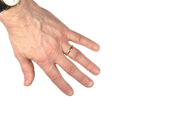 Hand spread: Isolated male left hand,with wedding ring and watch