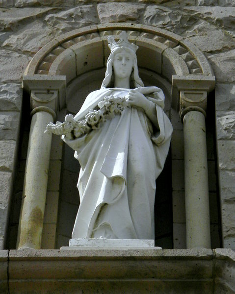 St. Elizabeth of Hungary: Some photos of the front statue on the historic church located on my college campus. It had been a rough week and though the statue was beautiful, I just saw the line of homeless people crowded behind the church.
