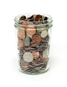 Savings: Jelly jar filled with change