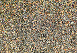 Shingle Texture: A close-up photo of the embedded granules of a house roofing shingle.