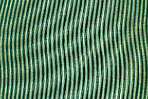 Wavy Fabric Texture: The top part of a canvas backed chair.