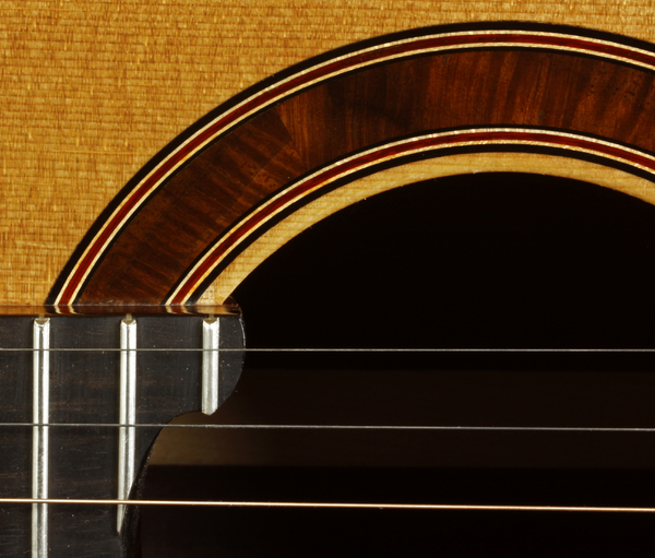 Custom Guitar Inlay Detail: A partial macro view of the detail of a guitar hole.