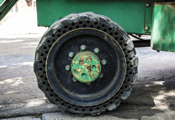 Solid Rubber Tractor Tire: Front tire of a tractor made from solid rubber and steel