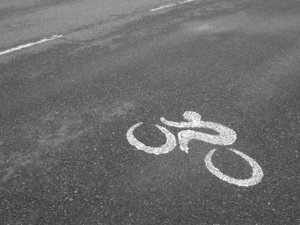 Bike lane: Quite unusual signalling icon painted on a stretch of road reserved for cycling. Picture taken at República de los Niños public park, Gonnet, La Plata, Argentina.