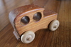 Wooden Toy 2: Wood car toy on a wooden floor.