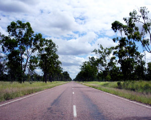 Open Road 1: Open road driving north in a remote area of Queensland.