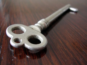 Key: An old fashioned key placed on a wooden background.This is a smaller version of the original which was uploaded to SXC about a year ago and had been downloaded 1101 times. The original has been moved to http://www.bigstockphoto. ..and can be bought for co