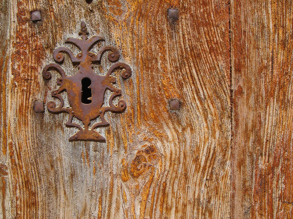 Keyhole 001: Keyhole on an aged wooden gate. Shot taken in Biar, Alicante.