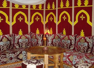 Moroccan restaurant: Red and gold MIddle Eastern decor in a cozy Morrocan restaurant.