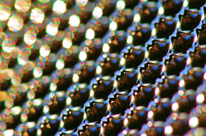 Grater glistening in the sunli: Grater with sun glistening on the sharp edges.
