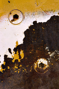 Paint and rust texture: Paint and rust texture on the side of a road making machine.