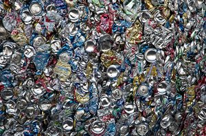 Recycling: Aluminum (aluminium) cans compressed into a large bale at a recycling facility.