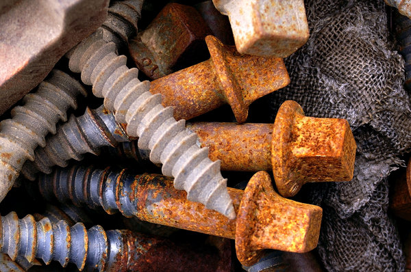 Rusted Bolts/Screws: Rusted bolts or screws found near some railroad tracks.