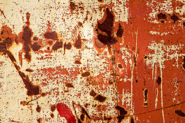 Old Paint: Old and weathered paint on a metal fence.