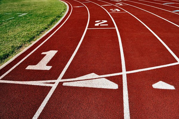 Track: Lanes of a running track at a school athletic field.