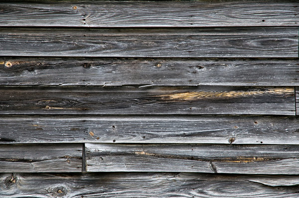 Wood wall: An old wall made of weathered wooden boards.