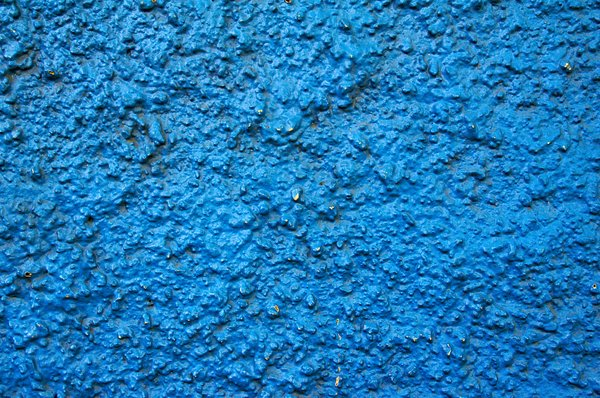 Blue wall texture: Textured and painted blue wall.
