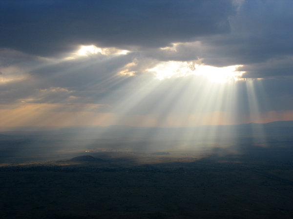 sunbeam: the sun breaking through clouds over new mexico.