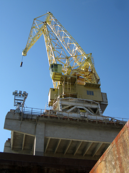 a crane of the shipyard: machinery of the shipyard of Riva T. Northern Italy