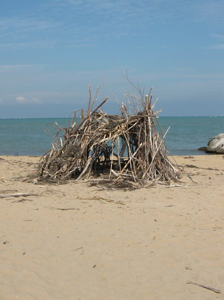 hut on the beach 2: hut made with branches, on a solitary beach