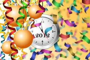 Happy New Year: Serpentine, christmas balls, clock and stars on a yellow background