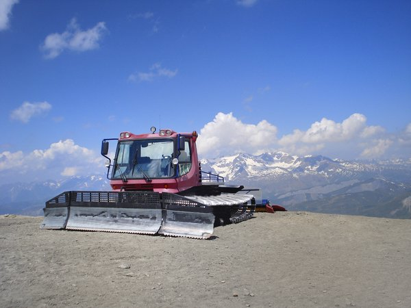 Snow shovel: snow shovel in summer on a mountain