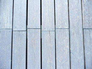 Weathered Planks: Wooden Planket on a balcony