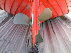 Ship's Screw: Red boat with ship's screw