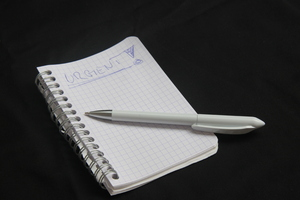 Urgent: Notepad with pen