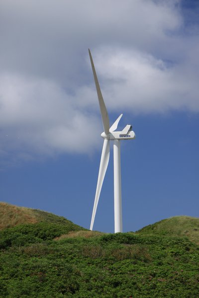 Wind Power 2: Wind mill at the beach, seen with dunes in front