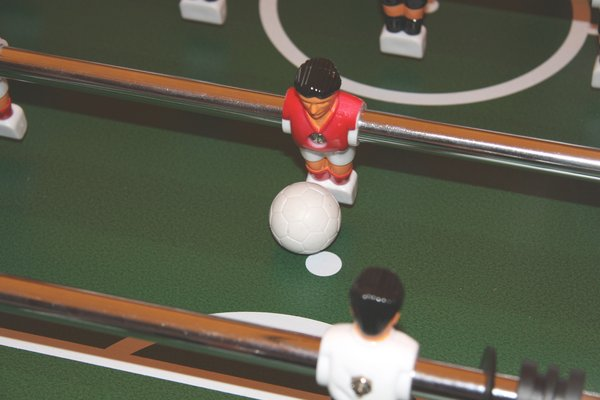 Kicker: player on a table football with ball