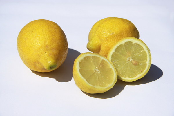 Citron: Three citrons, one of them cut through