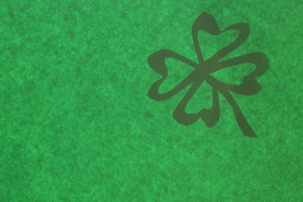 St. Patricks Day: Shamrock on sparkeling green background. Made for St. Patricks Day