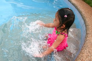 marge pool 1_040110: pool, pink, play, playing, water, summer, splash, swim, girl, child, female, kids, kid