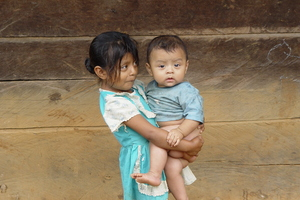 maternal care: A little girl takes care of his brother in Carchá, Guatemala