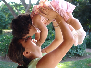 mother and daugther: A happy mother enjoys playing with her daugther.