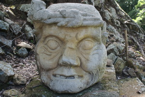 A Mayan stone face: A Mayan stone face as a relic of the Indians who lived in Copan Honduras many centuries ago.