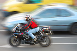 Speed of motorcycle: Motor-bike on the city street