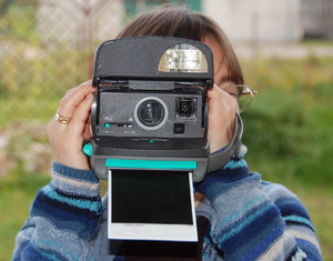 Making photo by instant camera: The instant camera is a type of camera with self-developing film