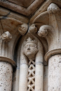 Decoration of gothic cathedral: Stone decoration of front side St. Stephen Cathedral in Harberstadt, Germany