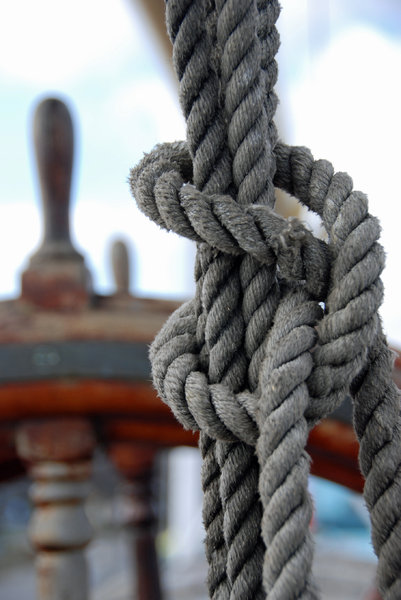 Knot on the deck of sail: Knot from lines on the deck old polish sail Dar Pomorza from Gdynia