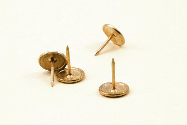 Four pins 3: Close-up of drawing pins or upholstering pins