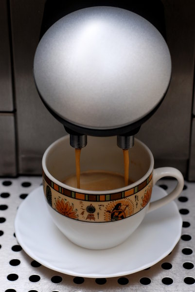 Making espresso in coffee mach: Espresso is a concentrated coffee beverage brewed by forcing very hot water under high pressure through coffee that has been ground to a consistency between extremely fine and powder.