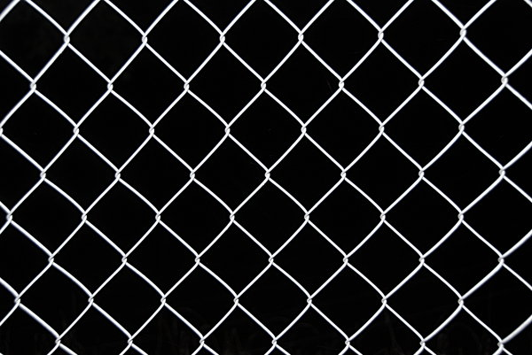 Wire netting texture 1: Netting fence on black background pattern